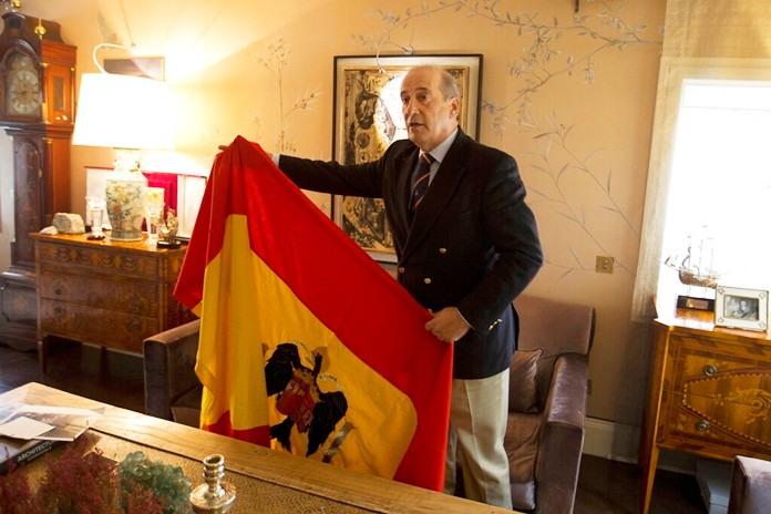 Spanish dictator General Francisco Franco's grandson, Francisco Franco Martinez-Bordiu holds up a pre-constitutional Spanish flag he wants draped over the coffin General Franco during his reburial Thursday after an interview with The Associated Press in Madrid, Spain, Wednesday, Oct. 23, 2019.