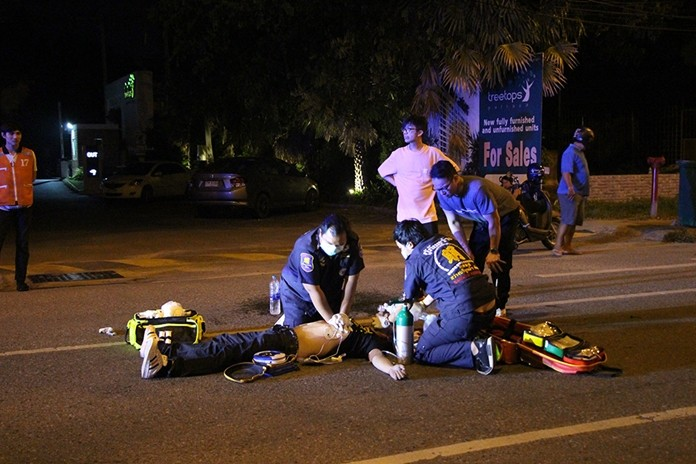 Rescue workers perform CPR before taking Katak Ho to hospital.