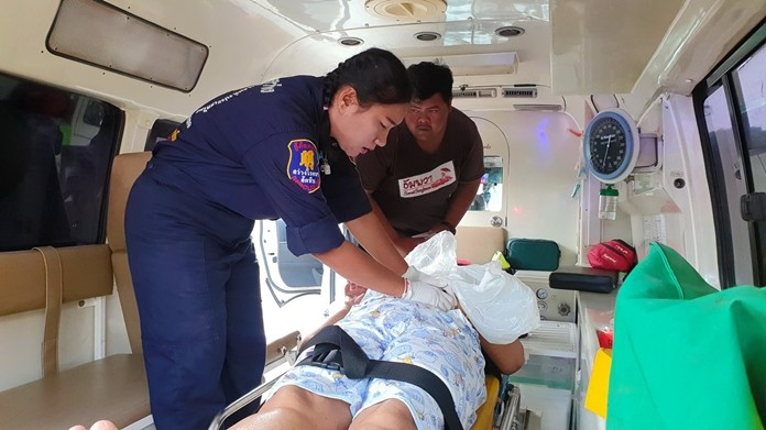Rescue workers rush the woman to hospital.