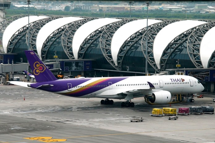 In this May 11, 2018, file photo, a Thai Airways jet parks at Suvarnabhumi Airport in Bangkok, Thailand. Thai Airways has disclosed that its chairman has resigned as the carrier struggles with financial challenges. (AP Photo/Sakchai Lalit, File)