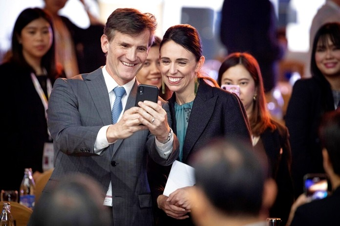 New Zealand Prime Minister Jacinda Ardern poses for a selfie with a visitor after delivering a speech in the ASEAN Business and Investment Summit (ABIS) in Nonthaburi, Thailand, Sunday, Nov. 3, 2019. (AP Photo/Wason Wanichakorn)