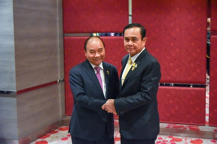 Prime Minister Gen Prayut Chan-o-cha greets Vietnamese Prime Minister Nguyen Xuan Phuc at the 35th ASEAN Summit and related summits in Bangkok.