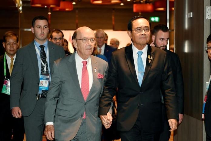 Gen Prayut Chan-o-cha walks hand in hand with U.S. Secretary of Commerce, Wilbur Ross.