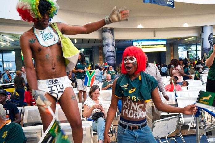 South African fans welcome their team's arrival at Johannesburg's O.R. Tambo airport Tuesday Nov. 5, 2019. (AP Photo/Jerome Delay)