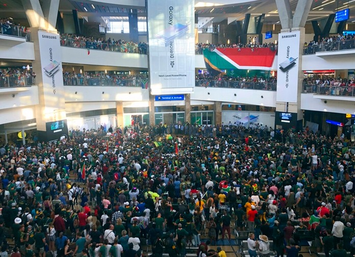 Fans await the arrival of the South Africa Springbok rugby team at the O.R. Tambo Airport in Johannesburg Tuesday, Nov. 5, 2019. (AP Photo/Jerome Delay