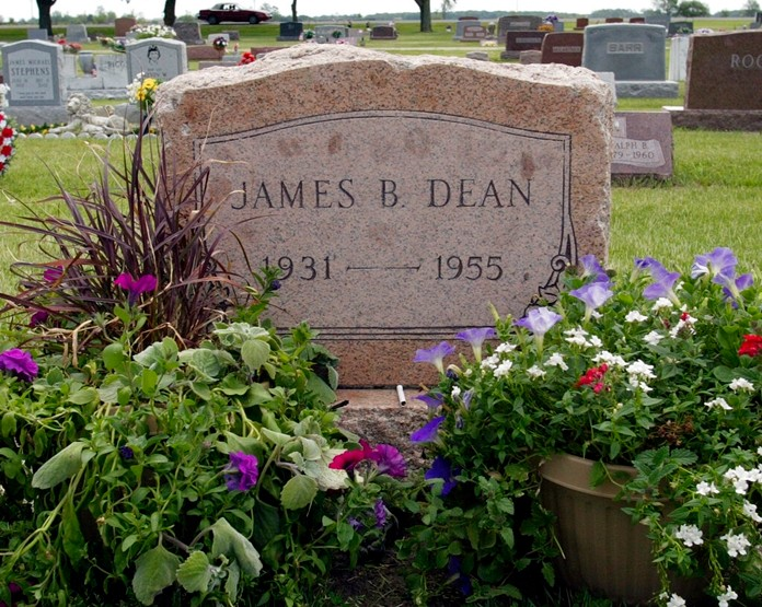 """This May 27, 2005 file photo shows plants and flowers at the grave of actor James Dean in Fairmount, Ind. Dean hasn't been alive in 64 years, but the """"Rebel Without a Cause"""" actor has been cast in a new film about the Vietnam War. The filmmakers behind the independent film """"Finding Jack"""" said Wednesday that a computer-generated Dean will play a co-starring role in the upcoming production. The digital Dean is to be assembled through old footage and photos and voiced by another actor. (AP Photo/John Harrell, File)"""