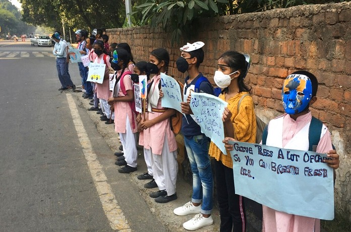 Schoolchildren protest outside the Indian Environment Ministry against alarming levels of pollution in the city, in New Delhi, India, Tuesday, Nov. 5, 2019. (AP Photo/Shonal Ganguly)