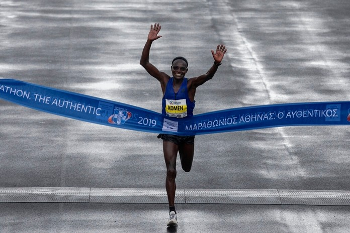John Kipkorir Komen of Kenya crosses the finish line to win the 37th Athens Marathon on Sunday, Nov, 10, 2019. The 42-year-old runner finished in a time of 2 hours, 16 minutes, 34 seconds, beating Rwanda's Felicien Muhitira, 17 years his junior, by nine seconds. (AP Photo/Yorgos Karahalis)