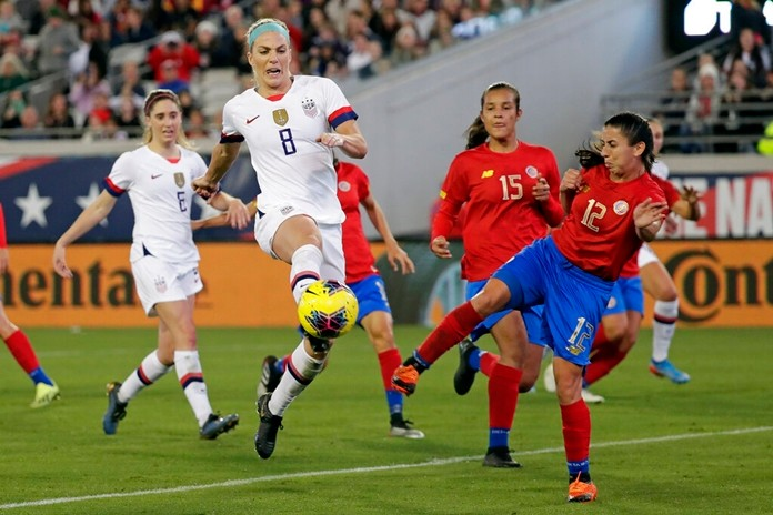 U.S. midfielder Julie Ertz (8) attempts a shot on goal off a corner kick, against Costa Rica defender Lixy Rodriguez (12) during the first half of an international friendly soccer match Sunday, Nov. 10, 2019, in Jacksonville, Fla. (AP Photo/John Raoux)