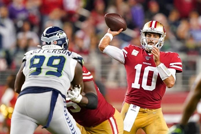 San Francisco 49ers quarterback Jimmy Garoppolo (10) passes against Seattle Seahawks defensive tackle Quinton Jefferson (99) during the second half. (AP Photo/Tony Avelar)