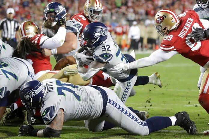 Seattle Seahawks running back Chris Carson (32) runs for a second half touchdown. (AP Photo/Ben Margot)