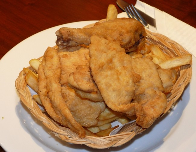 Chicken in the basket, served with French fries.