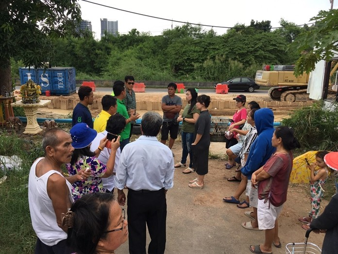 City contractors cleaned up ground water outside an East Pattaya neighborhood that was fouled by nearby construction.