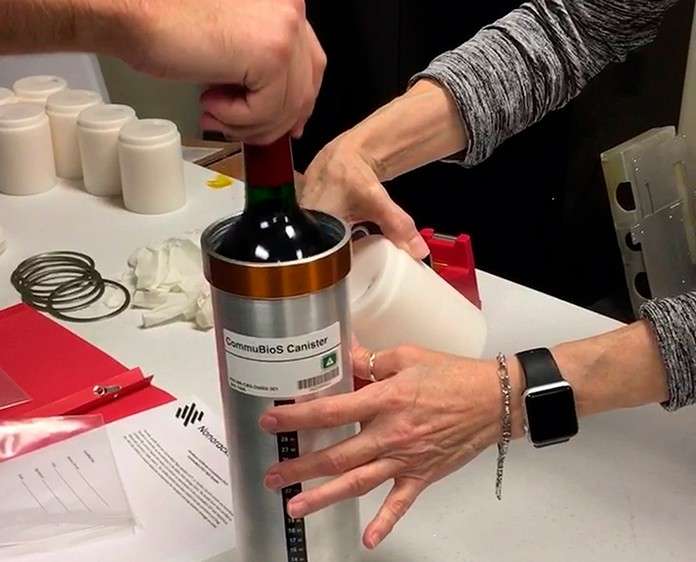 In this Saturday, Nov. 2, 2019 photo provided by Space Cargo Unlimited, researchers with Space Cargo Unlimited prepare bottles of French red wine to be flown aboard a Northrop Grumman capsule from Wallops Island, Va., to the International Space Station. The wine will age for a year up there before returning to the Luxembourg company. Company officials say researchers will study how weightlessness and space radiation affect the aging process. (Space Cargo Unlimited via AP)