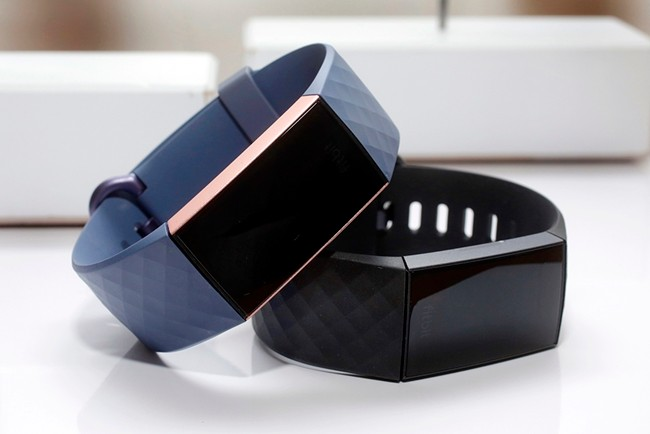 In this Aug. 16, 2018, file photo, the Fitbit Charge 3 fitness trackers are displayed in New York. Google's parent company is buying wearable device maker Fitbit for about $2.1 billion. Alphabet said Friday, Nov. 1, 2019, that it will pay $7.35 per share. (AP Photo/Richard Drew, File)