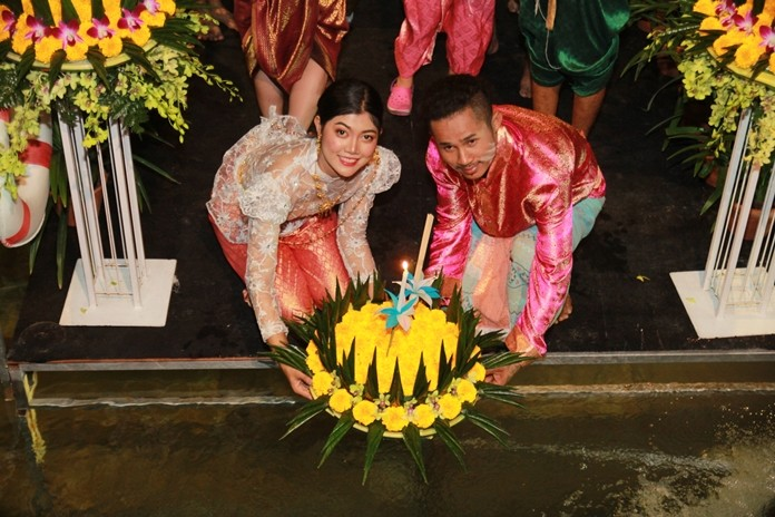 Thailand's night of love was filled with color and music as Pattaya celebrated Loy Krathong. Thousands of people flocked to Pattaya and Jomtien beaches and lakes to set free their floating flower, incense and candle krathongs with wishes for romance and good fortune. Shown here, a loving couple floats their krathong at the Centara Grand Mirage Beach Resort in Wong Amat.