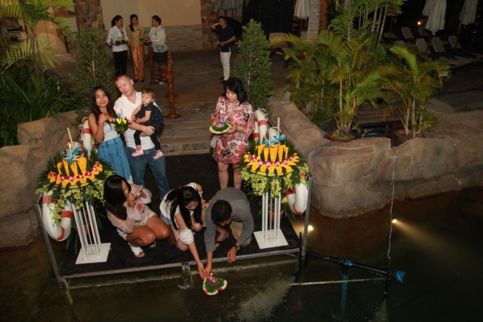 Lovers Thai and foreign float their krathongs at Centara Grand Mirage Beach Resort in Wong Amat.