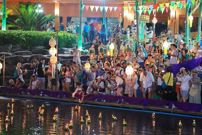 Russian tourists flock to the water's edge to float their krathongs at Nong Nooch.