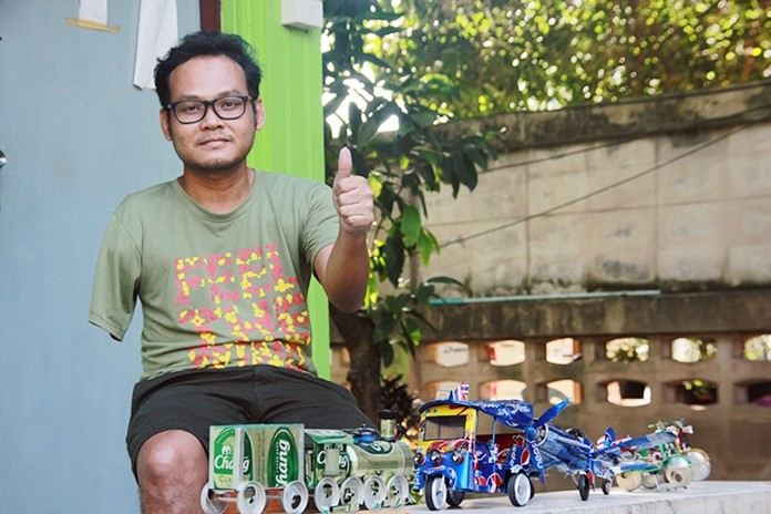 Palangkorn Auipako, who had his arm amputated at age 10, has learned to turn beer and soda cans into art.