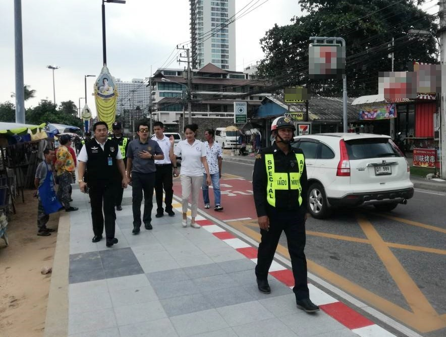 Komkrit Polwichid (wearing black vest with blue tag), head of the Pattaya Peace and Security Maintenance's Special Operations Unit, said protecting tourists is no longer just a job for Pattaya's police and fire department.