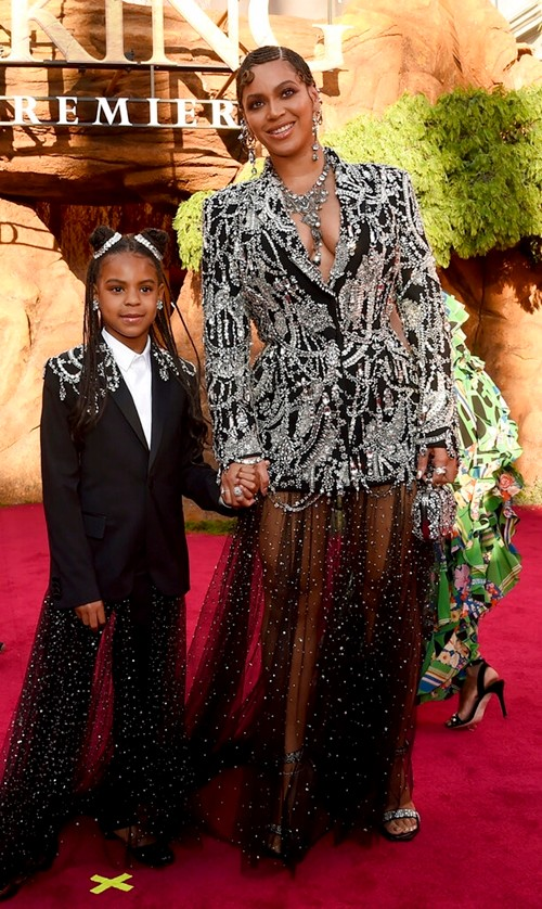 "Beyoncé, right, and her daughter Blue Ivy Carter arrive at the world premiere of ""The Lion King"". (Photo by Chris Pizzello/Invision/AP, File)"
