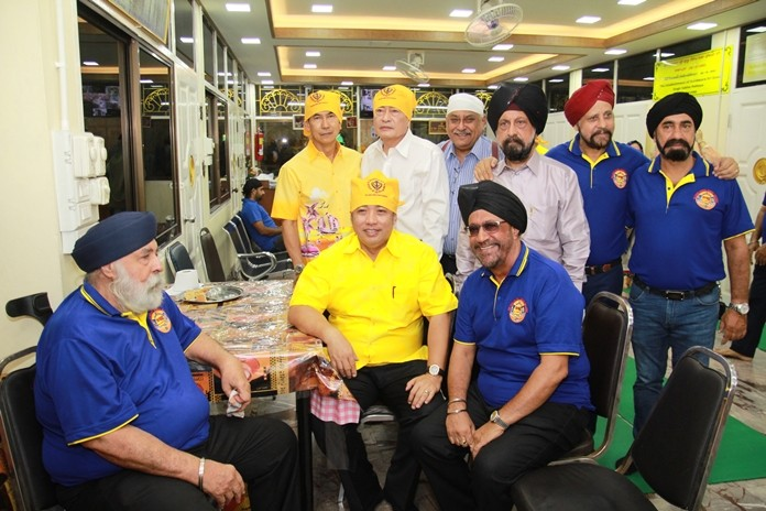 Mayor Sonthaya is surrounded by his old Sikh friends.