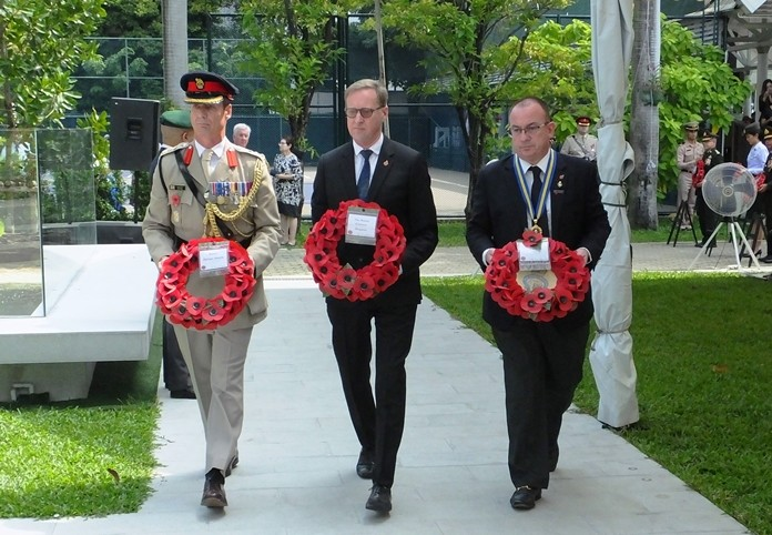 Colonel Roger Lewis, H.E. Brian Davidson, British Ambassador and Mark Bowling, President of the Royal British Legion lead the way in laying wreaths.