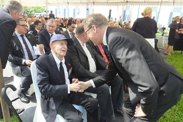 The British Ambassador greets Archie Dunlop.