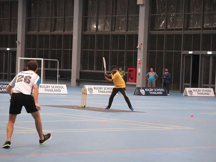 Bharat of AAS takes a swing as Will Howell of RST Cobras waits.