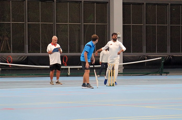 Umpire Clive Rogerson watches Bharat of the AAS bowling to Dan Allan of RST Vipers (not in picture) whilst Chris Sizer backs up.