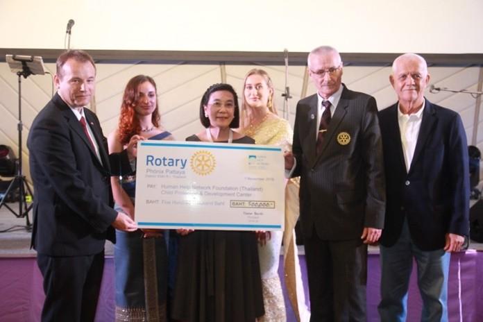 President Dieter Barth of the Rotary Club of Phoenix Pattaya presents a donation of 500,000 baht to Radchada Chomjinda, Director the Human Help Network Foundation (Thailand)