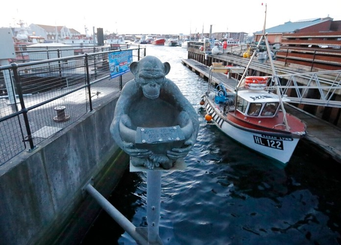 A wishing well, sculpted as a monkey at the Marina in Hartlepool, England, Monday, Nov. 11, 2019. Legend has it that during the Napoleonic Wars of the early 19th century, a shipwrecked monkey was hanged by the people of Hartlepool, believing him to be a French spy. (AP Photo/Frank Augstein)