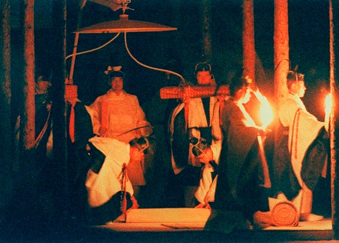 In this Nov. 1990, photo, then Japan's Emperor Akihito perform his harvest ritual, called Daijosai, or great thanksgiving festival at the Imperial Palace in Tokyo, Japan. Emperor Naruhito, the son of former Emperor Akihito, is set to perform his first annual harvest ritual since ascending to the Chrysanthemum Throne on Nov. 14, 2019. (Kyodo News via AP)