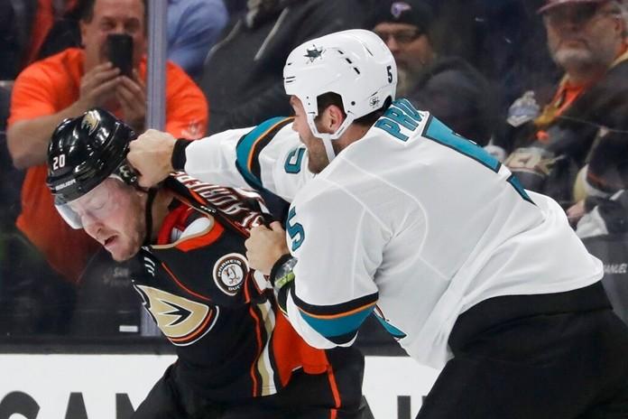 San Jose Sharks defenseman Dalton Prout, right, hits Anaheim Ducks left wing Nicolas Deslauriers during the first period of an NHL hockey game in Anaheim, Calif., Thursday, Nov. 14, 2019. (AP Photo/Chris Carlson)