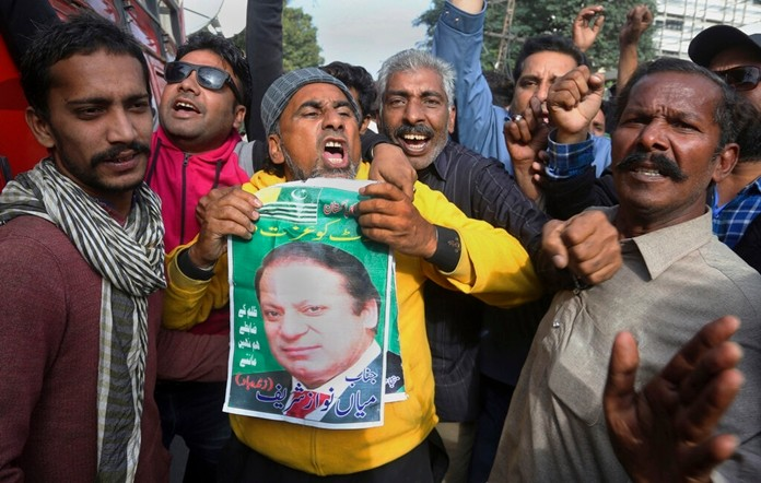 Supporters of Pakistani former Prime Minister Nawaz Sharif chant slogans outside the Lahore High court, in Lahore, Pakistan, Saturday, Nov. 16, 2019. (AP Photo/K.M. Chaudary)
