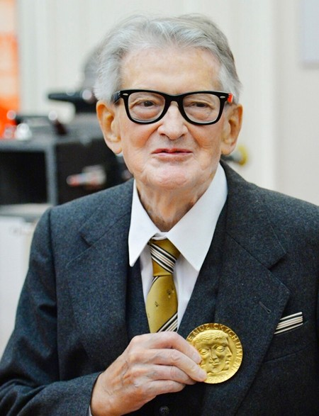 In this November 30, 2015, file photo, Vojtech Jasny, Czech film director and scriptwriter, poses for photographers as he receives gold medal of Academy of Performing Arts in Prague (AMU) on the occasion of his 90th birthday and AMUs 70th anniversary in Prague, Czech Republic. (Michal Dolezal/CTK via AP)