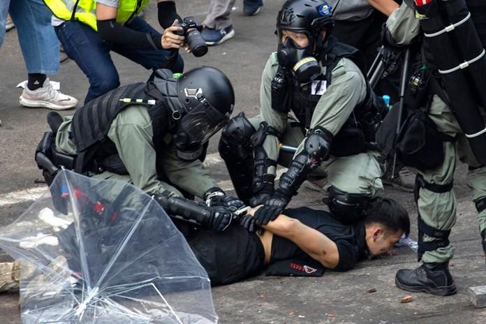 Police detain a protester at the Hong Kong Polytechnic University in Hong Kong, Monday, Nov. 18, 2019. (AP Photo/Ng Han Guan)