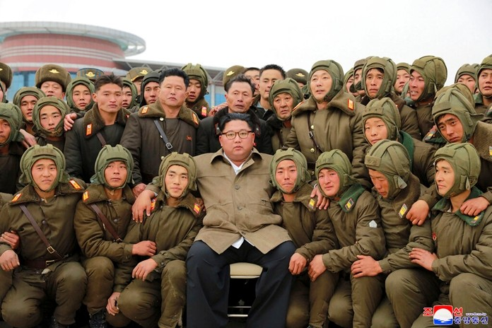 In this undated photo provided on Monday, Nov. 18, 2019, by the North Korean government, North Korean leader Kim Jong Un, center, poses with North Korean air force sharpshooters and soldiers for a photo at an unknown location in North Korea. The content of this image is as provided and cannot be independently verified. (Korean Central News Agency/Korea News Service via AP)