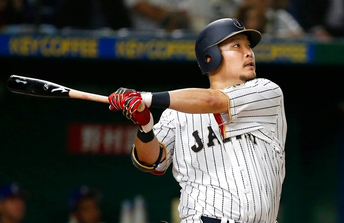 In this March 7, 2017, file photo, Japan's Yoshitomo Tsutsugo hits a two-run shot against Cuba's pitcher Jonder Martinez in the seventh inning of their first round game of the World Baseball Classic at Tokyo Dome in Tokyo. (AP Photo/Shizuo Kambayashi, File)