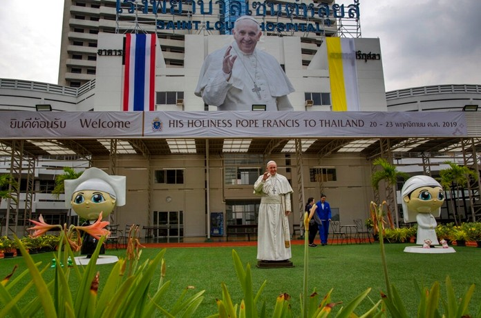 A billboard and a statue of Pope Francis marking his visit to Thailand is displayed at the Saint Louis hospital in Bangkok, Thailand Nov. 13, 2019. (AP Photo/Gemunu Amarasinghe)