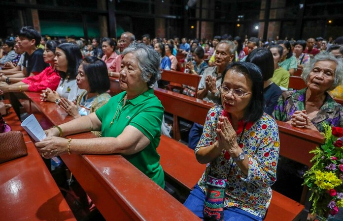 Catholics pray during the 30th anniversary of the beatification of the Seven Martyrs in the Christ Church in Songkhon village, Mukdahan province, northeastern of Thailand Nov. 13, 2019. (AP Photo/Sakchai Lalit)
