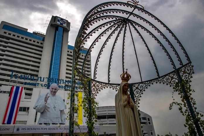 A billboard of Pope Francis marking his visit to Thailand is displayed at Saint Louis hospital in Bangkok, Thailand Nov. 13, 2019. (AP Photo/Gemunu Amarasinghe)