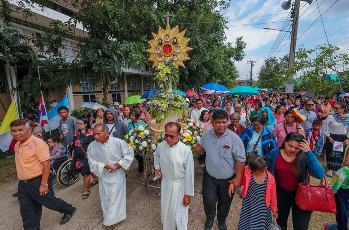 In this Saturday, Oct. 19, 2019, photo, Catholic devotees pull a pedestal with images of the Seven Martyrs at the Christ Church in the Songkhon village, Mukdahan province, northeastern Thailand. (AP Photo/Sakchai Lalit)