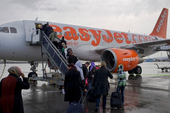 In this Thursday Oct. 18, 2012 file photo, passengers board a London-bound EasyJet flight at Amsterdam's Schiphol airport, Netherlands. (AP Photo/Peter Dejong, File)