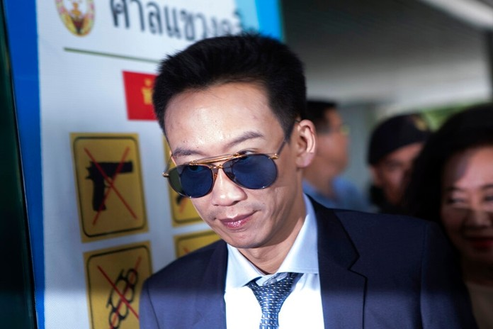Panthongtae Shinawatra , son of former Thai Prime Minister Thaksin Shinawatra, arrives at at the Central Criminal Court for Corruption and Misconduct Case in Bangkok, Thailand, Monday, Nov. 25, 2019. (AP Photo/Sakchai Lalit)