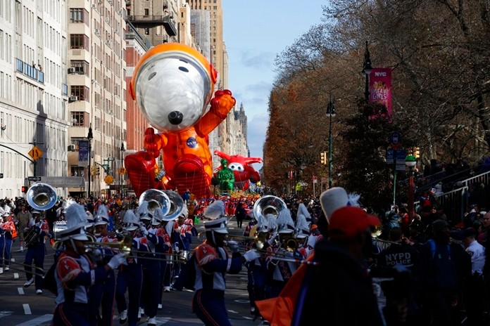 Astronaut Snoopy balloon makes its way down New York's Central Park West during the Macy's Thanksgiving Day Parade, Thursday, Nov. 28, 2019, in New York. (AP Photo/Eduardo Munoz Alvarez)