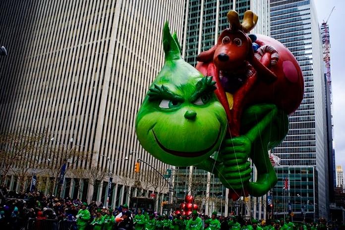 The Grinch balloon floats down Sixth Avenue during the Macy's Thanksgiving Day Parade, Thursday, Nov. 28, 2019, in New York. (AP Photo/Eduardo Munoz Alvarez)