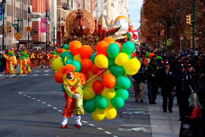 A clown with balloons fights with winds as it make its way down Columbus Circle during the Macy's Thanksgiving Day Parade, Thursday, Nov. 28, 2019, in New York. (AP Photo/Eduardo Munoz Alvarez)