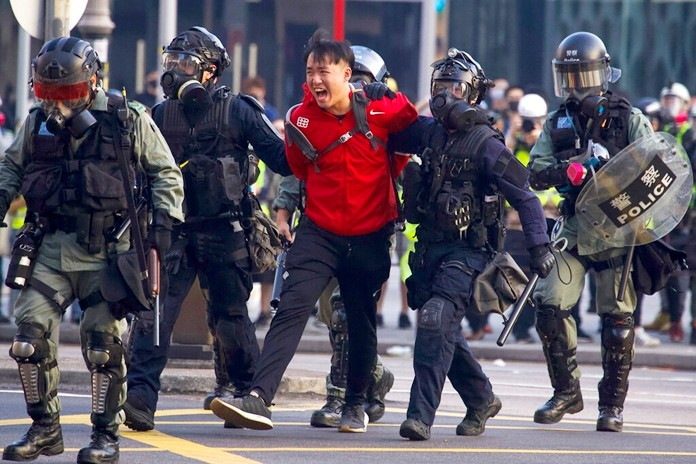 A pro-democracy protester shouts after being detained by policemen during a rally in Hong Kong, Sunday, Dec. 1, 2019. (AP Photo/Ng Han Guan)