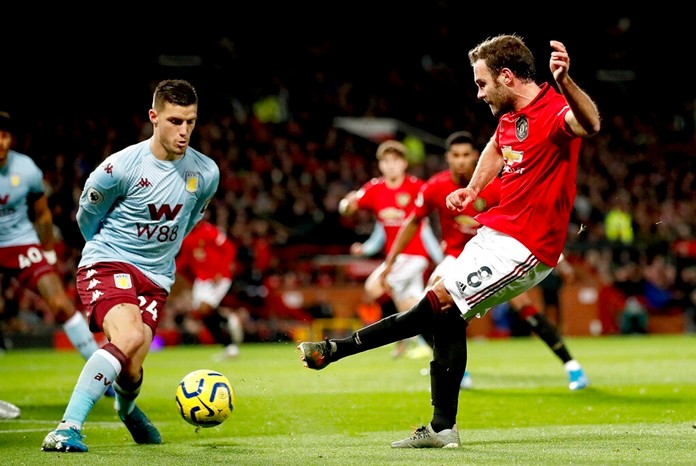 Manchester United's Juan Mata, right, in action during the English Premier League soccer match against Aston Villa at Old Trafford, Manchester, England, Sunday Dec. 1, 2019. (Martin Rickett/PA via AP)